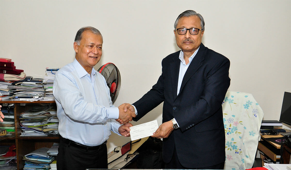 Honorable Vice Chancellor Prof. Saiful Islam receives the check from Mr. Kazi Zahedul Hasan.